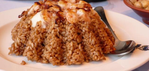 طريقة عمل أرز السمك البني