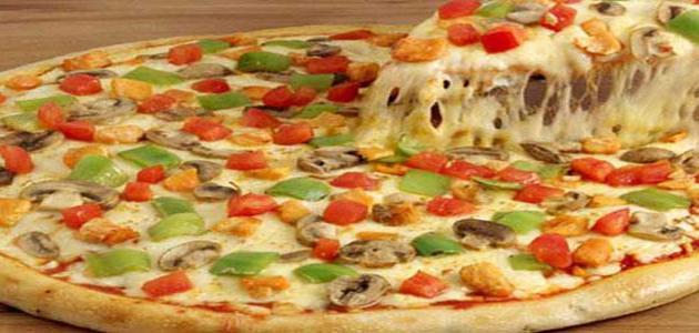 طريقة عمل كيكة البيتزا
