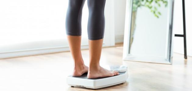 علاقة زيادة الوزن في الدورة الشهرية