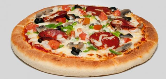 طريقة عمل عجينة بيتزا هشة