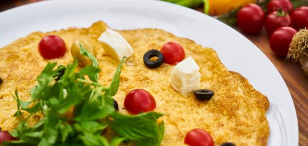 طريقة عمل بيض وطماطم وجبن