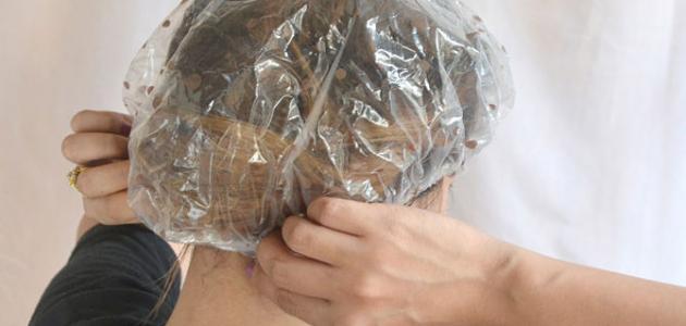 طريقة وضع الزيت على الشعر
