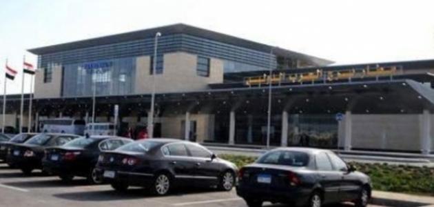 أين يقع مطار برج العرب