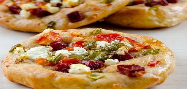 طريقة عمل البيتزا دوائر صغيرة